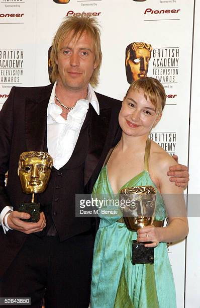 Rhys Ifans and Anamaria Marinca pose in the awards room at The Pioneer British Academy Television Awards at the Theatre Royal on April 17 2005 in...