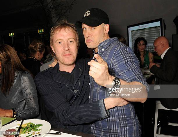 Rhys Ifans and Tom Hardy attend Gabrielle's Gala 2013 supported by Lorraine Schwartz at Battersea Power Station on May 2 2013 in London England
