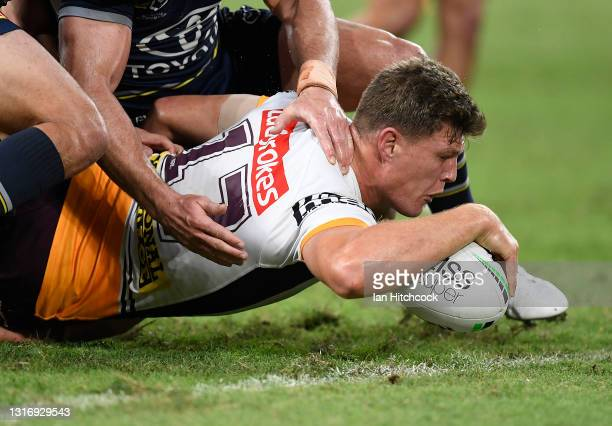 Rhys Kennedy of the Broncos scores a try during the round nine NRL match between the North Queensland Cowboys and the Brisbane Broncos at QCB...