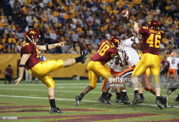 Rhys Lloyd of the Minnesota Gophers punts during the game against the Illinois Fighting Illini at the Hubert H Humphrey Metrodome on October 23 2004...