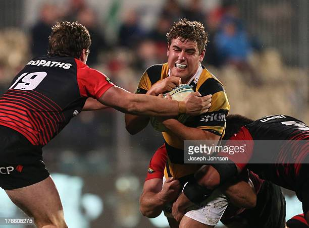Rhys Marshall of Taranaki runs with the ball during the round 1 ITM Cup match between Cantebury and Taranaki at AMI Stadium on August 16 2013 in...