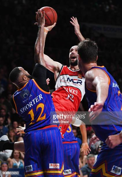 Rhys Martin of the Illawarra Hawks shoots over Shannon Shorter of the Adelaide 36ers during the round 15 NBL match between the Adelaide 36ers and the...