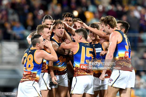 Rhys Mathieson of the Lions celebrates kicking a goal during the round 11 AFL match between the Brisbane Lions and the Hawthorn Hawks at The Gabba on...