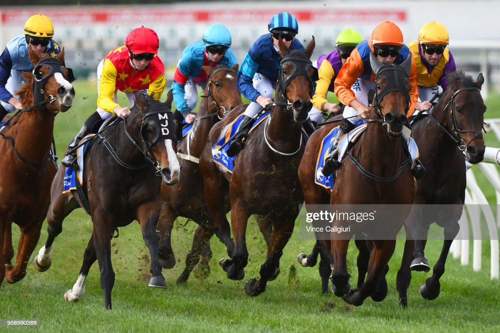 Rhys McLeod riding Chiavari (r) rails up on the home turn before winning Race 3 during Melbourne Racing at Sandown Hillside on May 16, 2018 in Melbourne, Australia.
