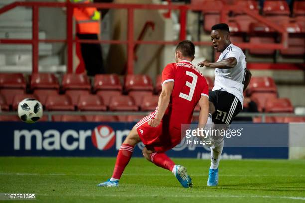 Rhys Norrington-Davies of Wales and Bote Baku of Germany battle for the ball during the international friendly match between U21 Wales and U21...