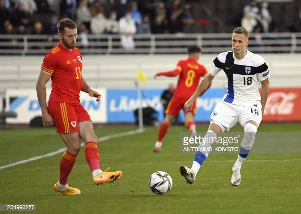 Rhys Norrington-Davies of Wales and Finland's Santeri Hostikka vie for the ball during the international friendly football match Finland vs Wales at...