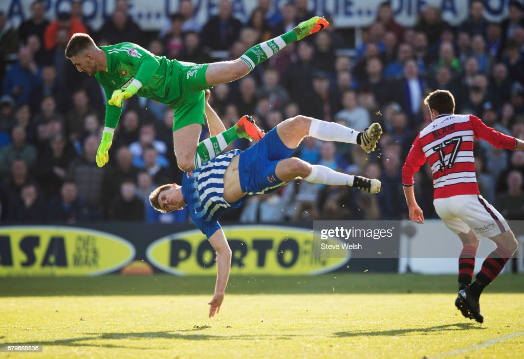 Rhys Oates (bottom) of Hartlepool gets taken down by Ian Lawlor (top) of Doncaster Rovers during the Sky Bet League Two match between Hartlepool and Doncaster at Victoria Park on May 6, 2017 in Hartlepool, England.