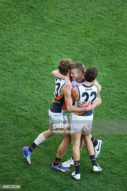 Rhys Palmer Devon Smith and Josh Kelly of the Giants celebrate a goal during the round 21 AFL match between the Melbourne Demons and the Greater...
