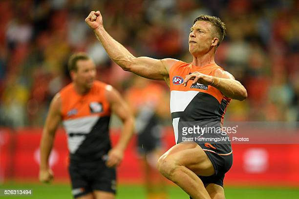 Rhys Palmer of the Giants celebrates after kicking a goal during the round six AFL match between the Greater Western Sydney Giants and the Hawthorn...