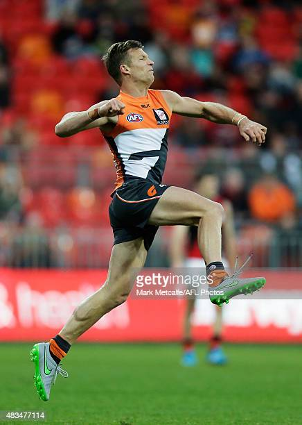 Rhys Palmer of the Giants celebrates kicking a goal during the round 19 AFL match between the Greater Western Sydney Giants and the Essendon Bombers...