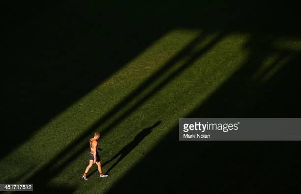 Rhys Palmer of the Giants walks onto the field during the round 16 AFL match between the Greater Western Giants and the Adelaide Crows at Spotless...