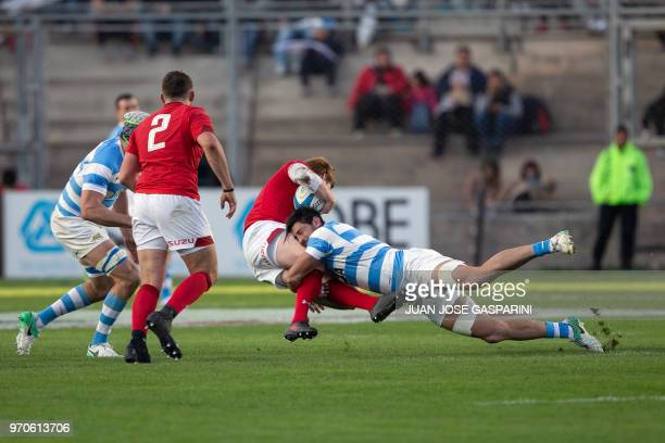 Rhys Patchell from Wales is tackled by Javier Ortega from Argentina during the International Test Match between Argentina and Wales at the San Juan...