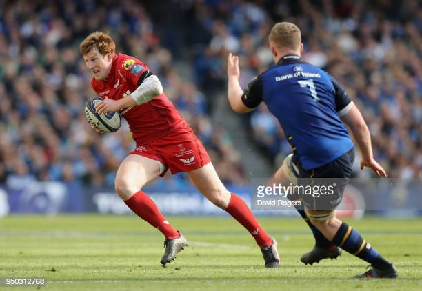 Rhys Patchell of the Scarlets runs with the ball during the European Rugby Champions Cup SemiFinal match between Leinster Rugby and Scarlets at Aviva...