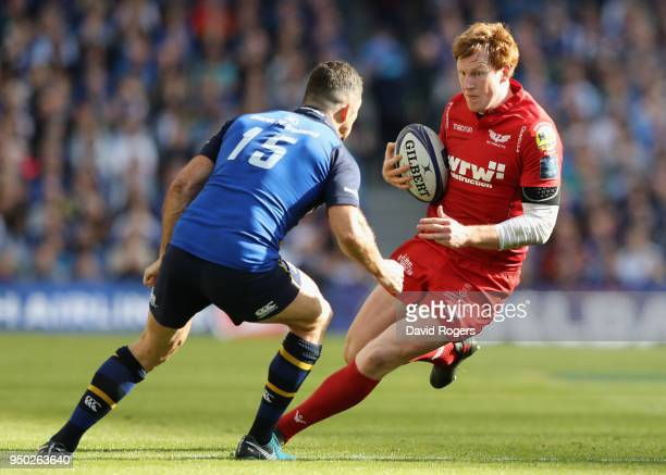 Rhys Patchell of the Scarlets takes on Rob Kearney during the European Rugby Champions Cup SemiFinal match between Leinster Rugby and Scarlets at...