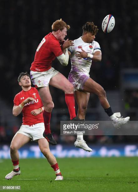 Rhys Patchell of Wales and Anthony Watson of England battle for the ball during the NatWest Six Nations round two match between England and Wales at...