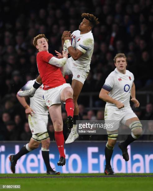 Rhys Patchell of Wales and Anthony Watson of England clash during the NatWest Six Nations round two match between England and Wales at Twickenham...
