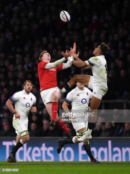 Rhys Patchell of Wales and Anthony Watson of England jump for the ball during the NatWest Six Nations round two match between England and Wales at...