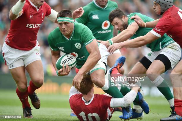 Rhys Patchell of Wales and CJ Stander of Ireland during the Guinness Summer Series match between Ireland and Wales at Aviva Stadium on September 7...