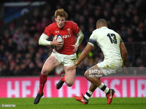 Rhys Patchell of Wales breaks with the ball under pressure from Jonathan Joseph of England during the NatWest Six Nations round two match between...