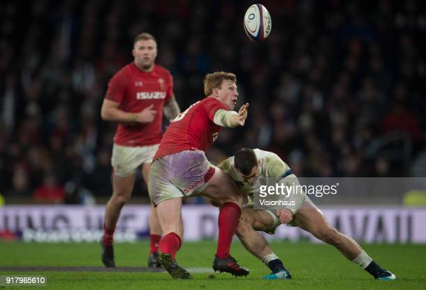 Rhys Patchell of Wales is tackled by Jonny May of England during the NatWest Six Nations match between England and Wales at Twickenham Stadium on...