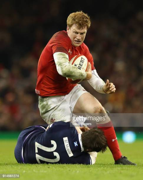 Rhys Patchell of Wales is tackled by Pete Horne during the NatWest Six Nations match between Wales and Scotland at the Principality Stadium on...