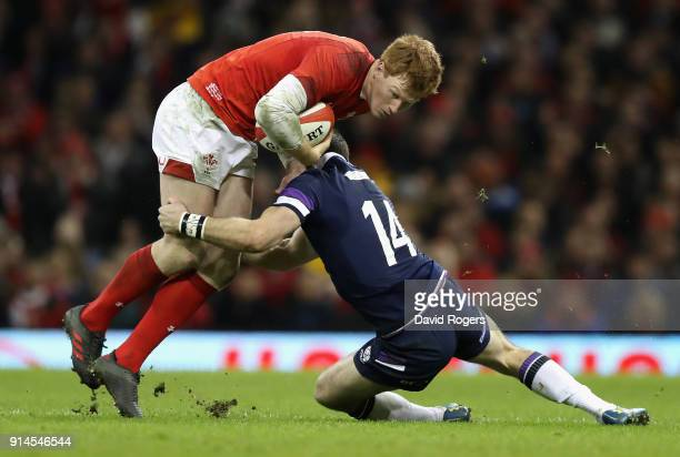 Rhys Patchell of Wales is tackled during the NatWest Six Nations match between Wales and Scotland at the Principality Stadium on February 3 2018 in...
