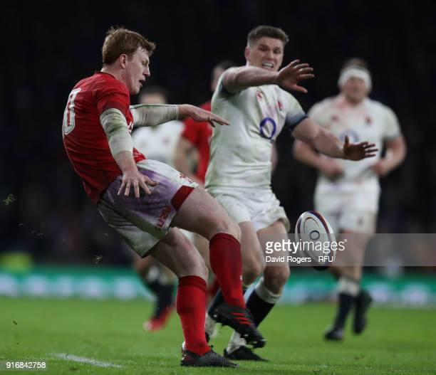 Rhys Patchell of Wales kicks the ball upfield as Owen Farrell attempts to block during the NatWest Six Nations match between England and Wales at...