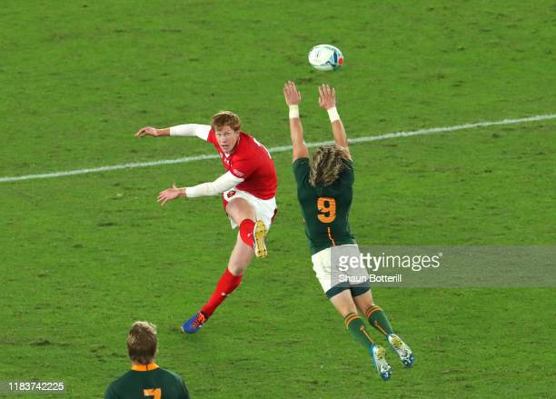 Rhys Patchell of Wales misses a drop goal attempt as Faf de Klerk of South Africa pressures during the Rugby World Cup 2019 SemiFinal match between...
