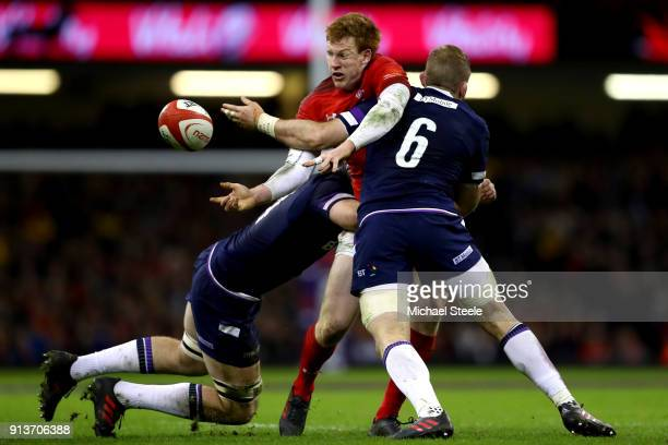 Rhys Patchell of Wales offloads a pass during the Natwest Six Nations round One match between Wales and Scotland at Principality Stadium on February...