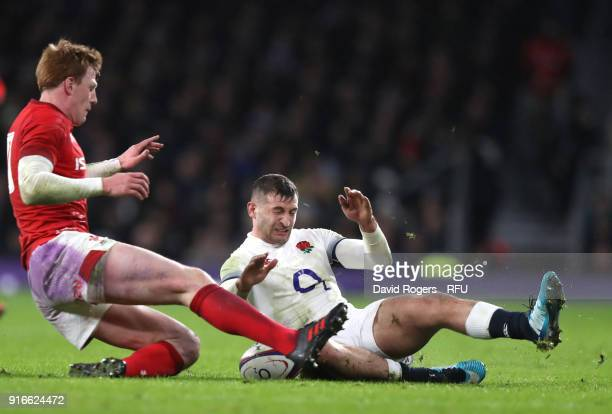 Rhys Patchell of Wales tackles Jonny May of England during the NatWest Six Nations round two match between England and Wales at Twickenham Stadium on...