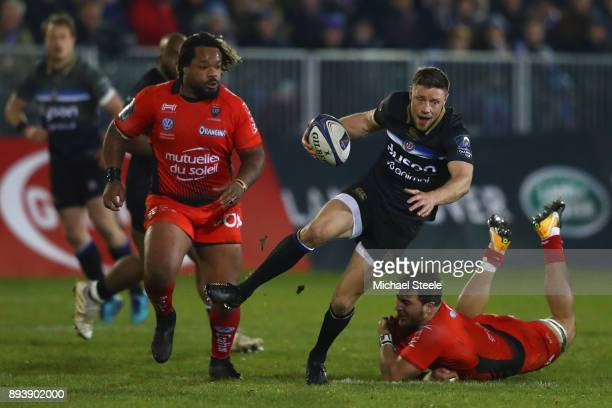 Rhys Priestland of Bath cuts between Isa Facundo and Bastareaud Mathieu of Toulon during the European Rugby Champions Cup match between Bath Rugby...