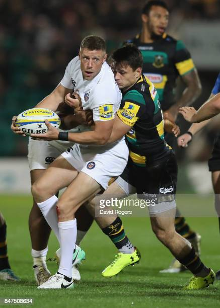 Rhys Priestland of Bath is tackled by Tom Collins during the Aviva Premiership match between Northampton Saints and Bath Rugby at Franklin's Gardens...