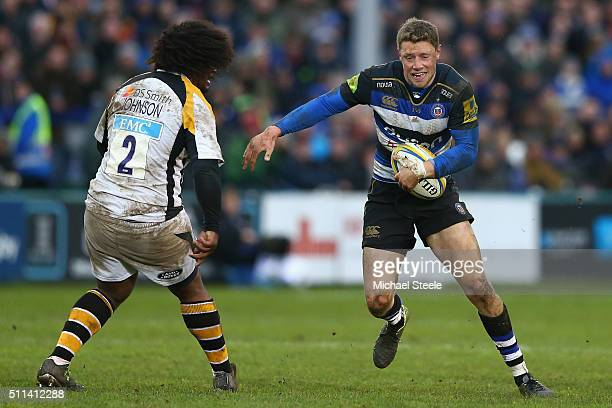 Rhys Priestland of Bath runs at Ashley Johnson of Wasps during the Aviva Premiership match between Bath and Wasps at the Recreation Ground on...