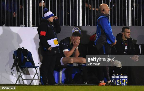 Rhys Priestland of Bath sits dejected on the bench after going off injured during the European Rugby Champions Cup match between Bath Rugby and...