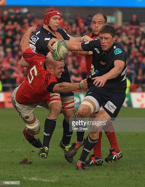 Rhys Priestland of Scarlets is tackled by Paul O'Connell of Munster during the Heineken Cup match between Munster and Scarlets at Thomond Park on...