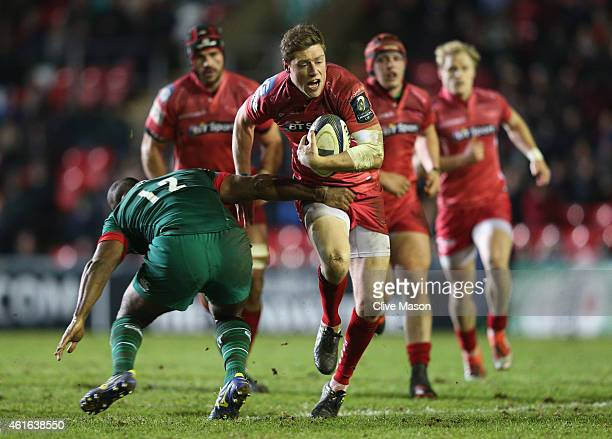 Rhys Priestland of scarlets is tackled by Seremaia Bai of Leicester Tigers during the European Rugby Champions Cup Group 3 match between Leicester...