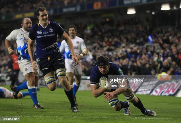 Rhys Ruddock of Leinster scores a try during the Heineken Cup match between Leinster and Bath at Aviva Stadium on December 17 2011 in Dublin Ireland