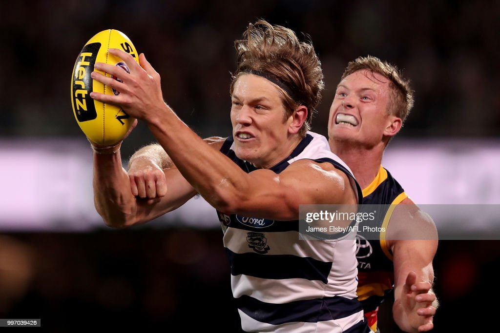 Rhys Stanley of the Cats marks the ball in front of Alex Keath of the Crows during the 2018 AFL round 17 match between the Adelaide Crows and the Geelong Cats at Adelaide Oval on July 12, 2018 in Adelaide, Australia.