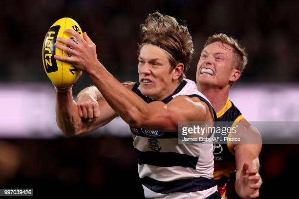 Rhys Stanley of the Cats marks the ball in front of Alex Keath of the Crows during the 2018 AFL round 17 match between the Adelaide Crows and the...