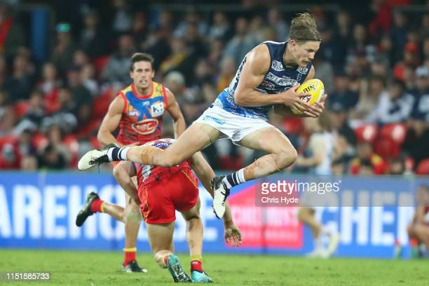 Rhys Stanley of the Cats takes a mark during the round 10 AFL match between the Gold Coast Suns and the Geelong Cats at Metricon Stadium on May 25,...