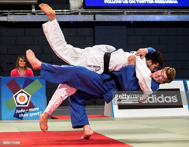 Rhys Thompson of Great Britain attempts to counter Rico Harder of Holland without a score eventually losing the contest by an ippon to Harder who...
