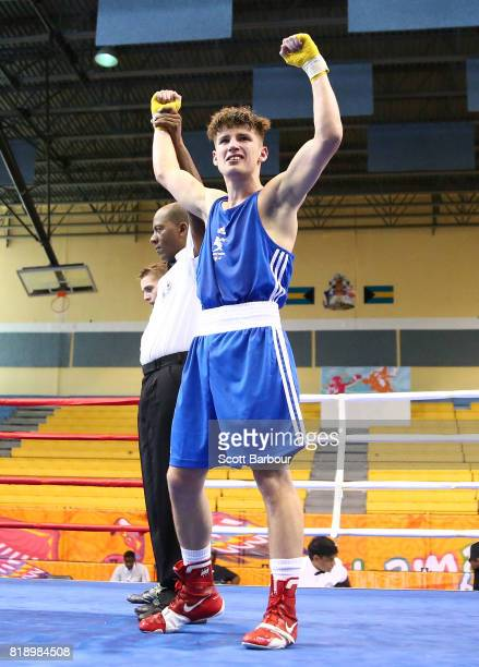 Rhys Tomas Edwards of Wales celebrates defeating Dominic Bradley of Northern Ireland in the Boy's 60 kg Preliminary Bout Boxing on day 2 of the 2017...