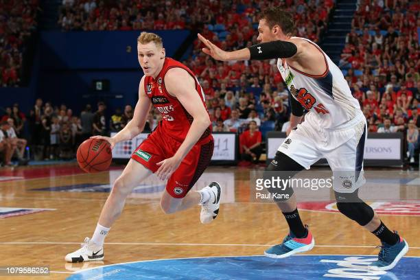 Rhys Vague of the Wildcats drives to the basket against Alex Loughton of the Taipans during the round eight NBL match between the Perth Wildcats and...