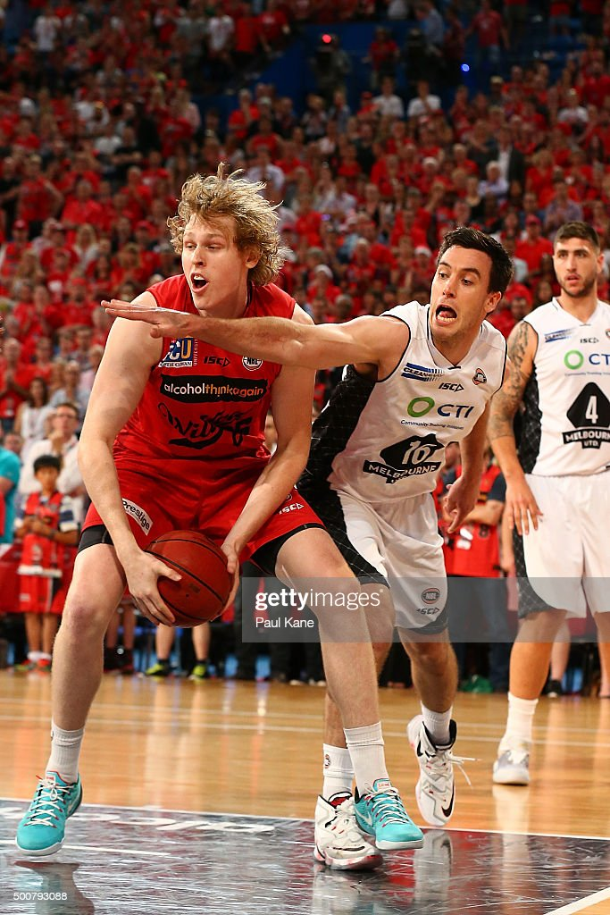 Rhys Vague of the Wildcats gets fouled by Brad Hill of United during the round 10 NBL match between the Perth Wildcats and Melbourne United at Perth Arena on December 10, 2015 in Perth, Australia.