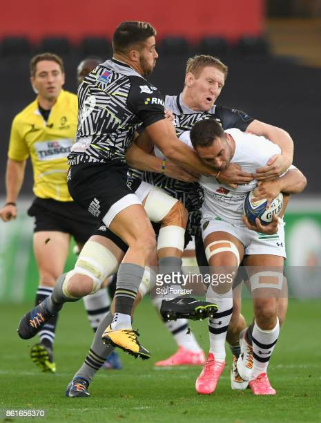 Rhys Webb and Bradley Davies combine to stop Alexandre Lapandry of Clermont during the European Rugby Champions Cup match between Ospreys and ASM...