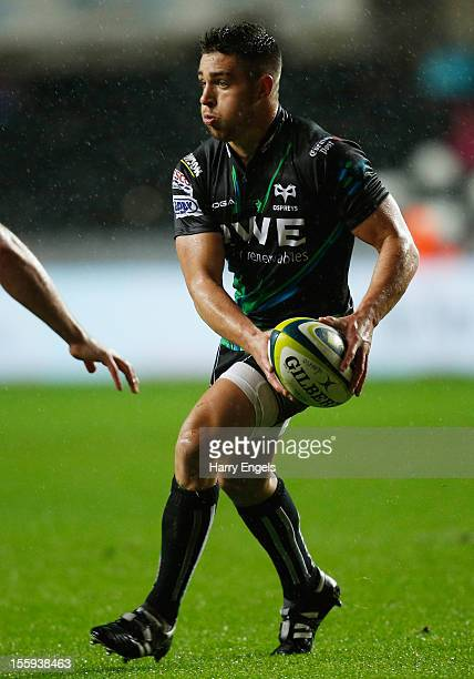 Rhys Webb of Ospreys runs with the ball during the LV= Cup Round 1 match between Ospreys and Gloucester at the Liberty Stadium on November 9 2012 in...