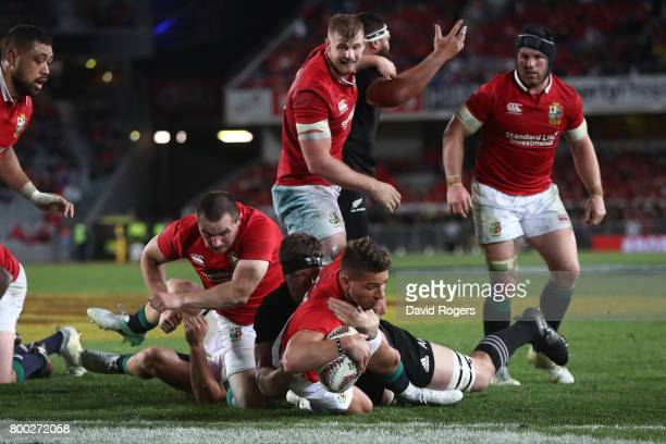 Rhys Webb of the Lions barges past Scott Barrett of the All Blacks to score his team's second try during the first test match between the New Zealand...