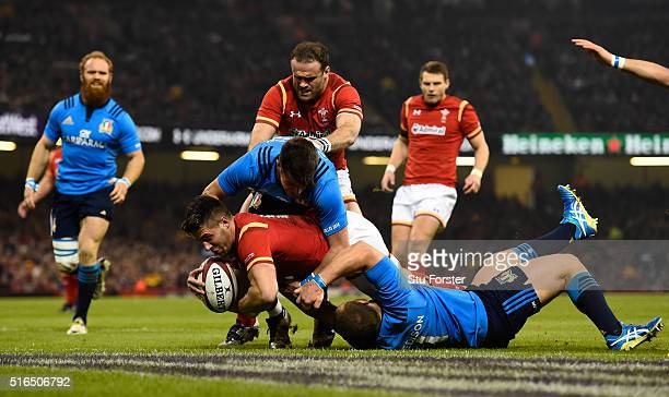 Rhys Webb of Wales crashes over to score the opening try during the RBS Six Nations match between Wales and Italy at the Principality Stadium on...