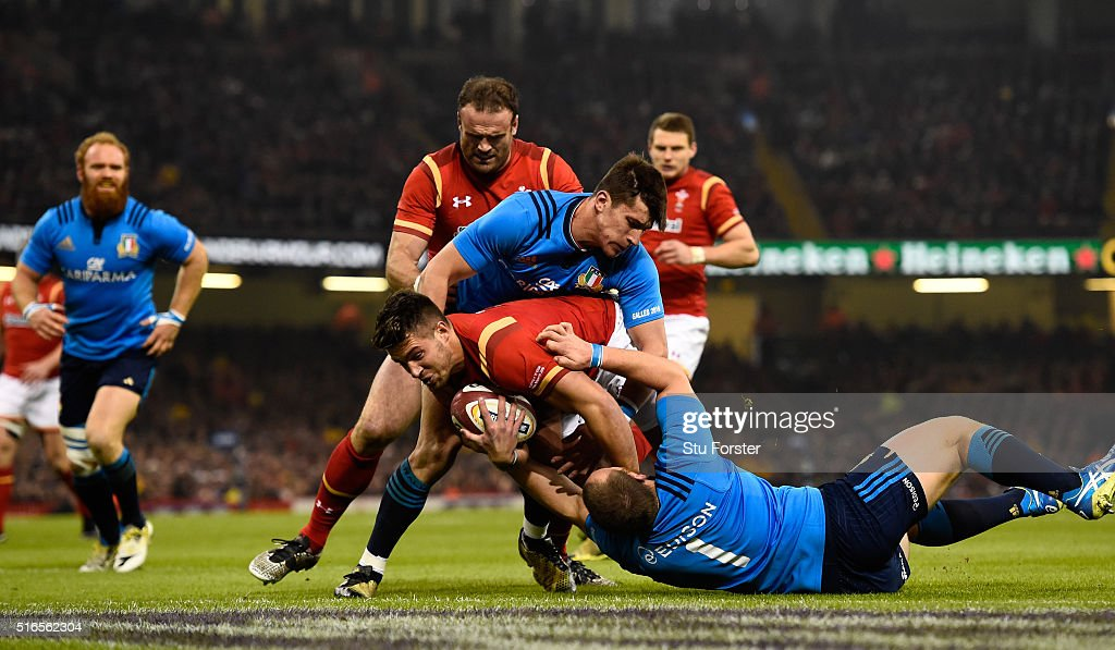 Rhys Webb of Wales crashes through to score the first try during the RBS Six Nations match between Wales and Italy at the Principality Stadium on March 19, 2016 in Cardiff, Wales.