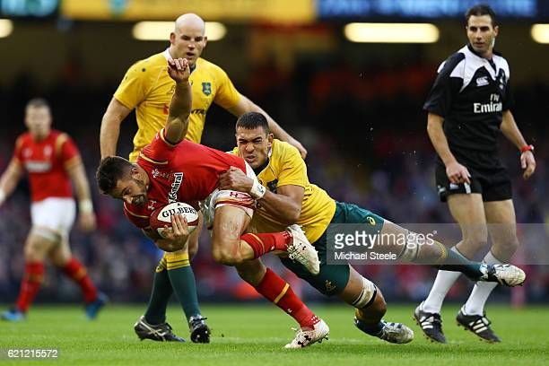 Rhys Webb of Wales is hauled down by Rory Arnold of Australia during the international match between Wales and Australia at the Principality Stadium...